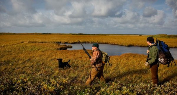Lg two men and a black dog hunting 725x477
