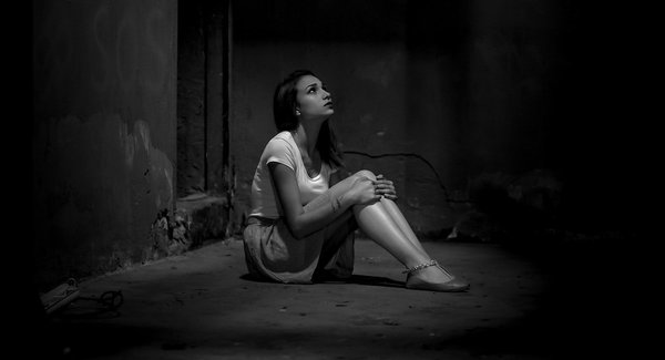 Lg monochrome photo of woman sitting on floor   original